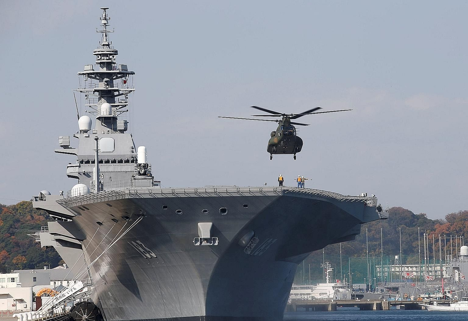 A helicopter landing on the Izumo at the Japan Maritime Self Defence Force's Yokosuka base south of Tokyo.