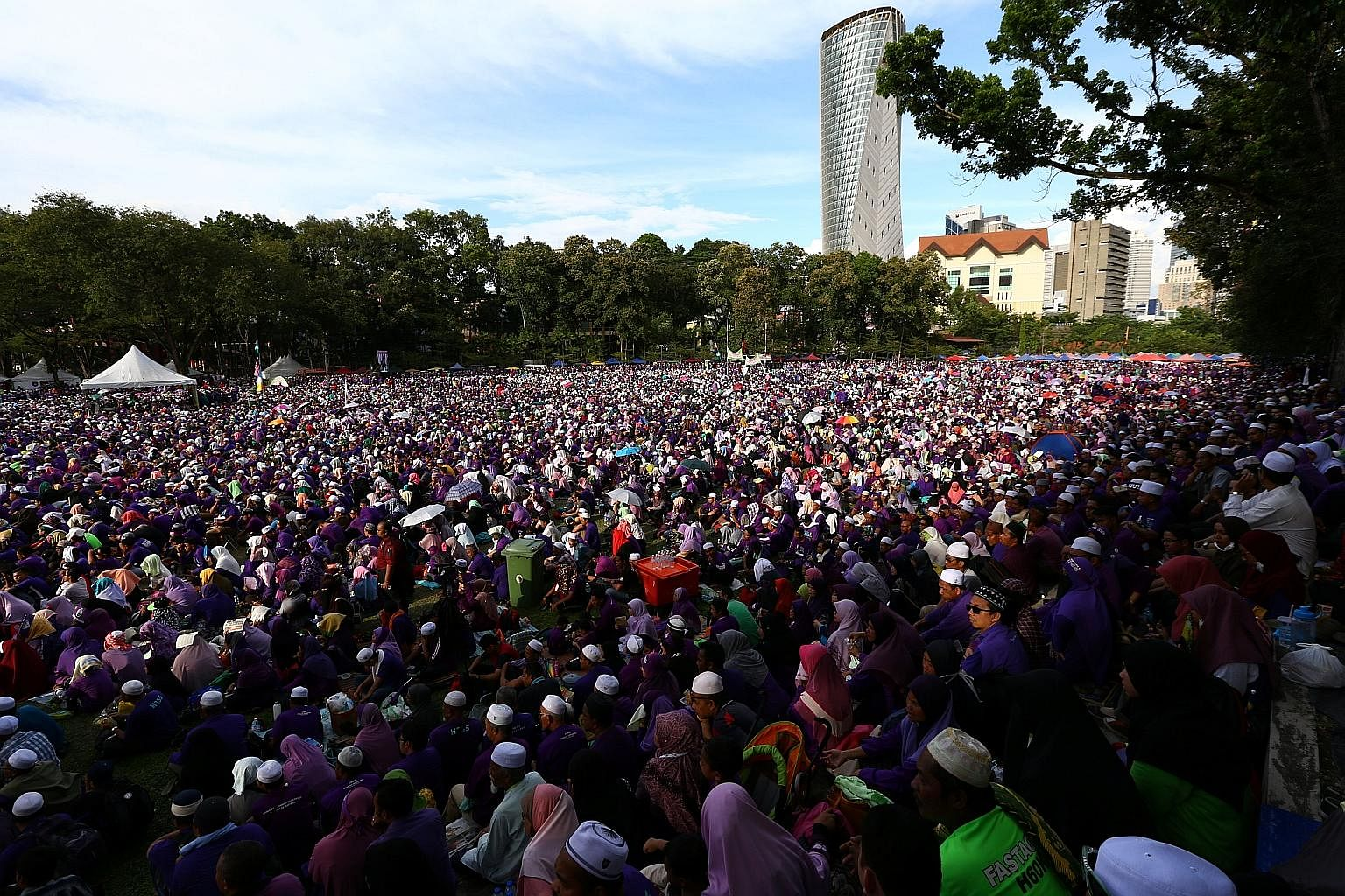 A crowd at a rally to support the adoption of a strict Islamic penal code at Padang Merbok in Kuala Lumpur last month. Umno, the dominant component of the Barisan Nasional coalition, does not have enough votes to push the Bill through Parliament. But