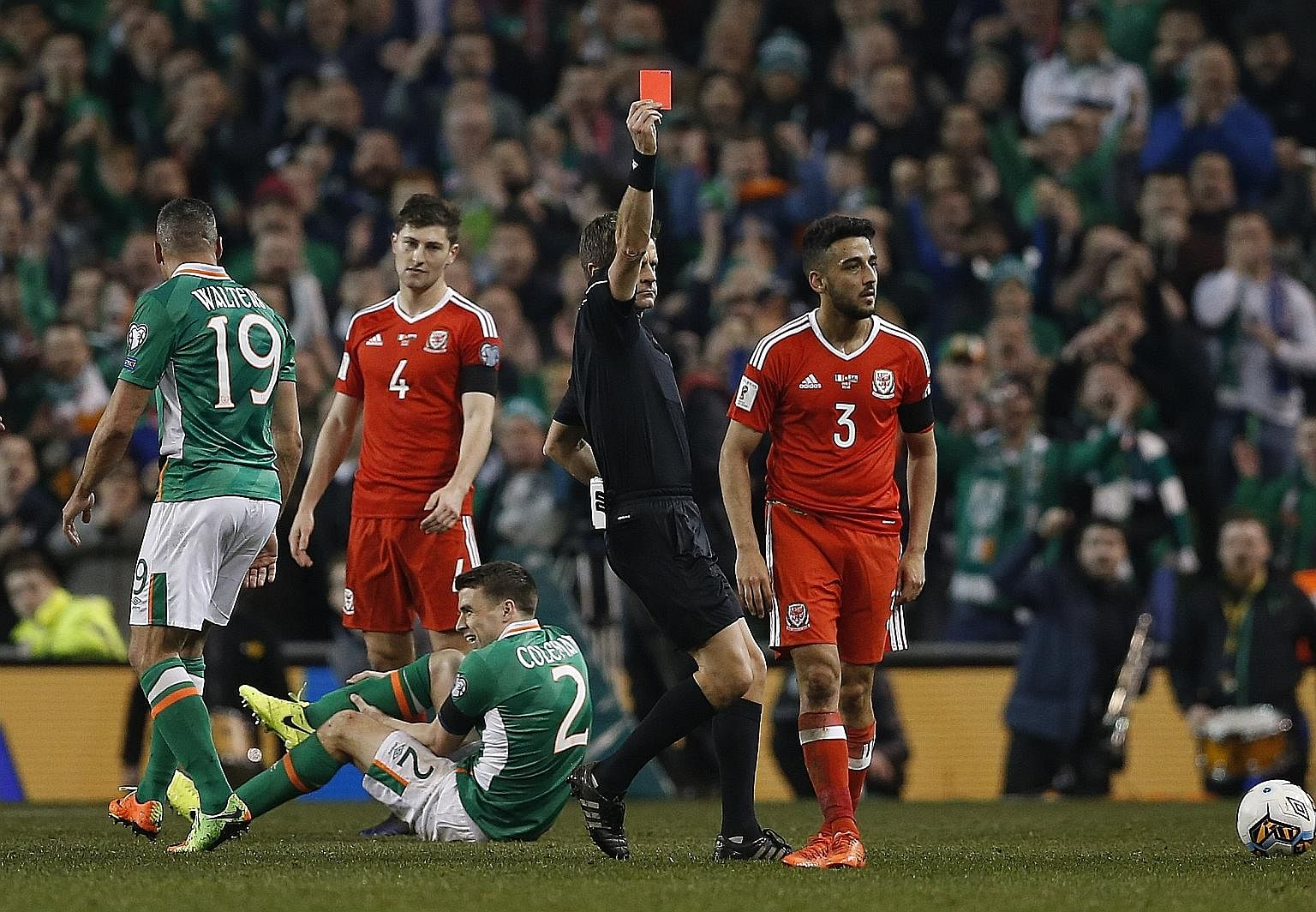 Wales defender Neil Taylor (right) receiving his marching orders after fouling Ireland's Seamus Coleman during a World Cup qualifier. His tackle left the defender with a double leg break.