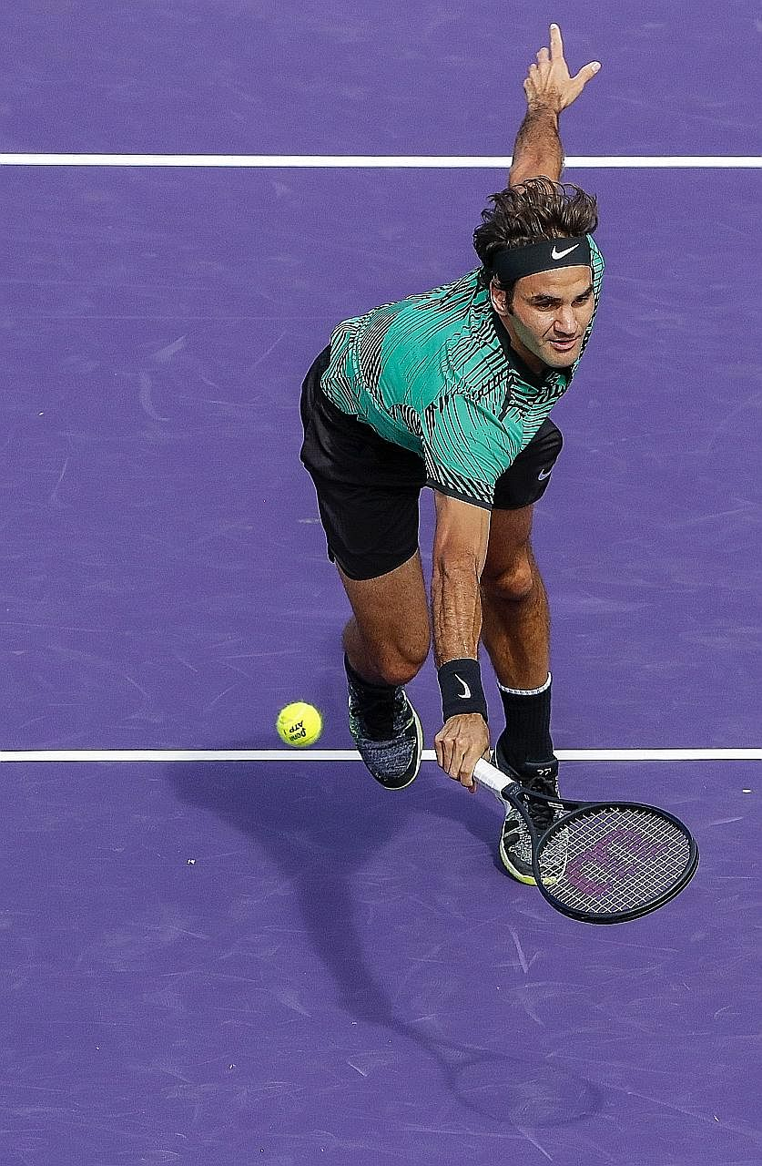 Tennis great Roger Federer stretches to return a shot against Tomas Berdych at the Miami Open. Federer won 89 total points in their semi-final - two fewer than the Czech, but prevailed after Berdych double-faulted on match point.