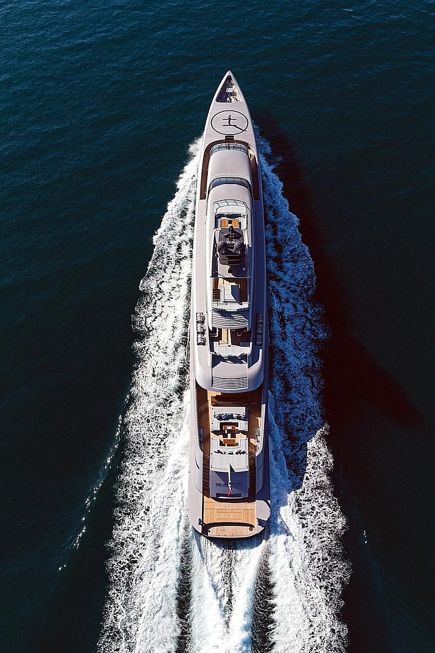 The 77m-long Silver Fast (left) can accommodate 18 guests in seven en suite cabins and a dedicated owner's apartment. The 41m-long Ocean Emerald (top), which has open exterior deck spaces for al fresco dining, a jacuzzi (above), home cinema and cappu