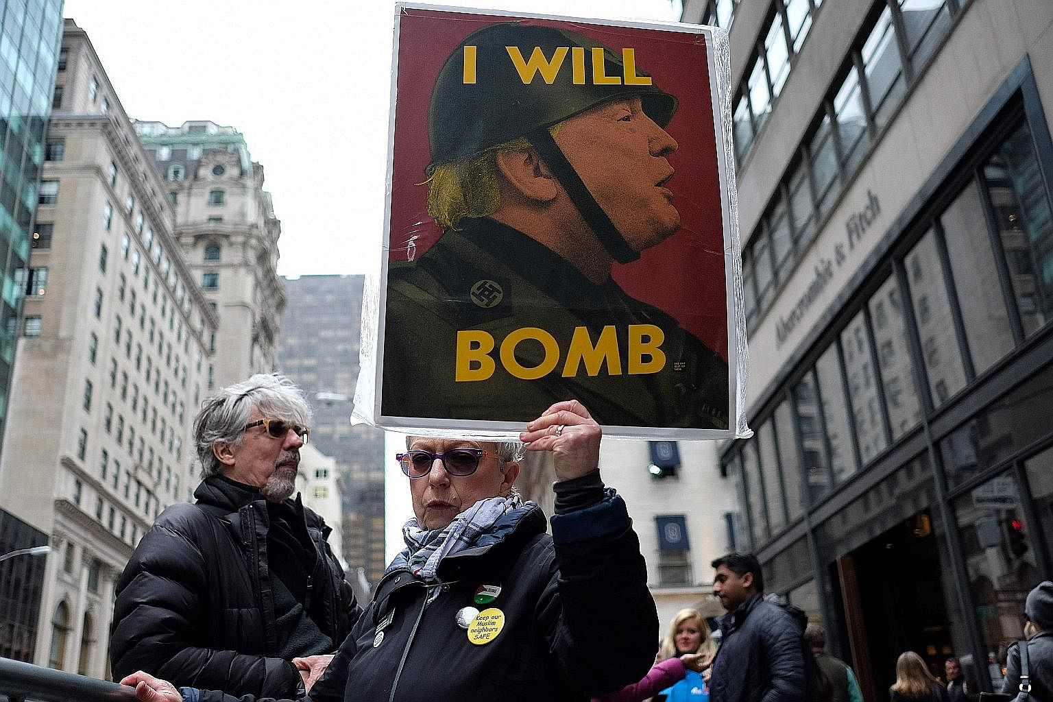 An anti-war protester displaying a placard decrying the US air strike on Syria on Friday. President Donald Trump launched a strike on an airfield in retaliation for Syria's use of chemical weapons last week.
