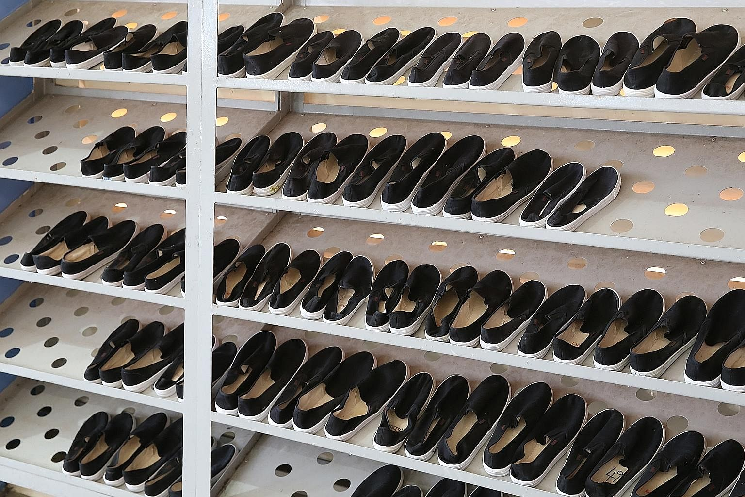 In their spare time, inmates get to read newspapers to keep up with current affairs. They are supplied with shoes, lined up on shelves in the yard, for their ball games. All DRC inmates are detained for drug consumption. An offender can be sent to th