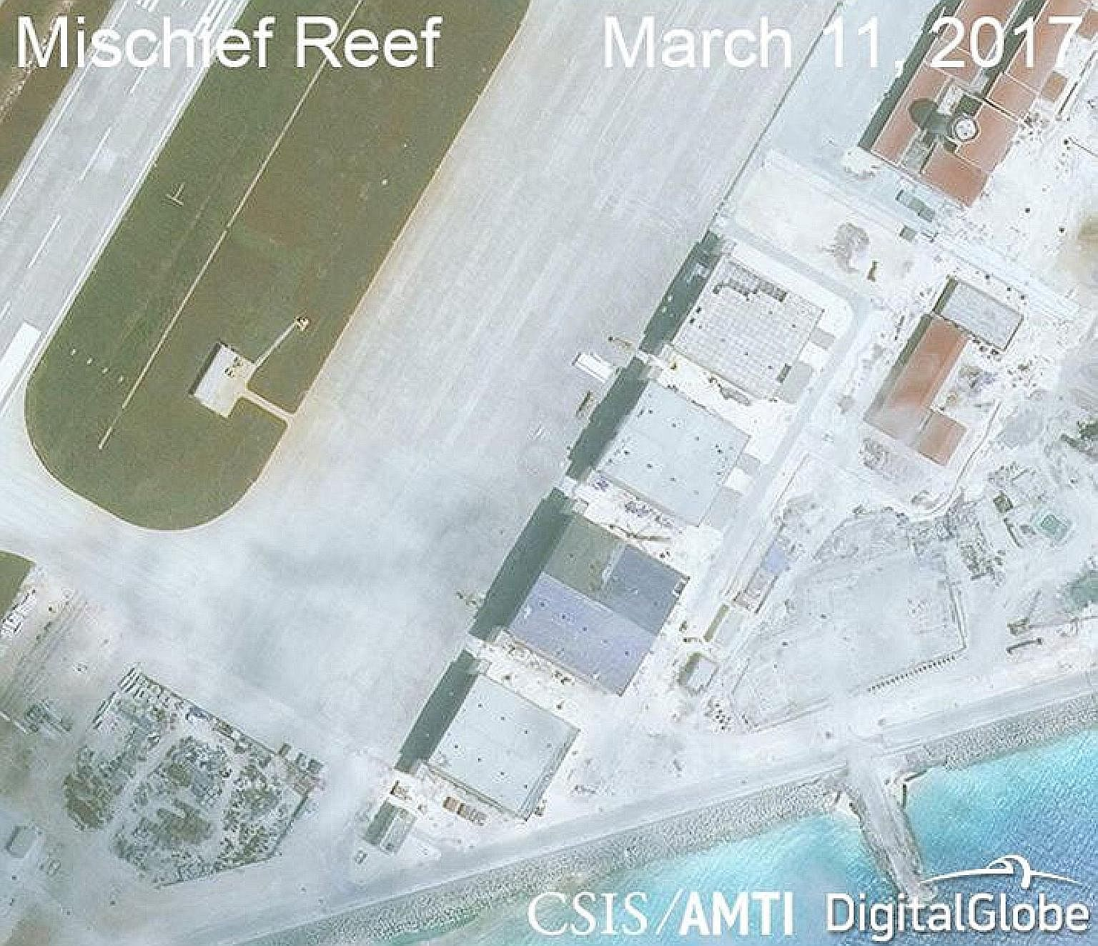 China has started construction work on several land features in the Spratly Island