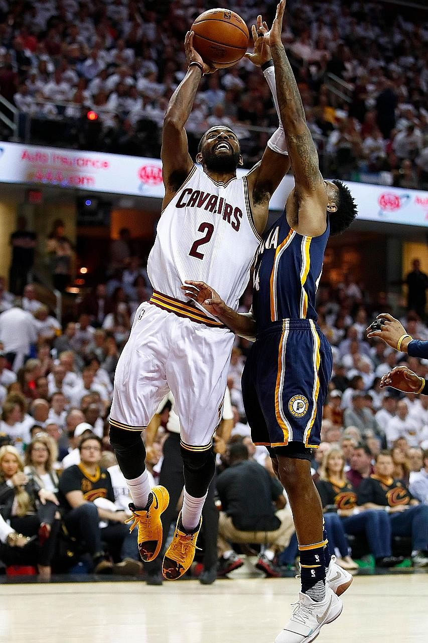 Kyrie Irving getting a shot over the Pacers' Jeff Teague. The Cavaliers point guard led all scorers with 37 points to help hosts Cleveland to a 117-111 win in their Eastern Conference first-round tie.