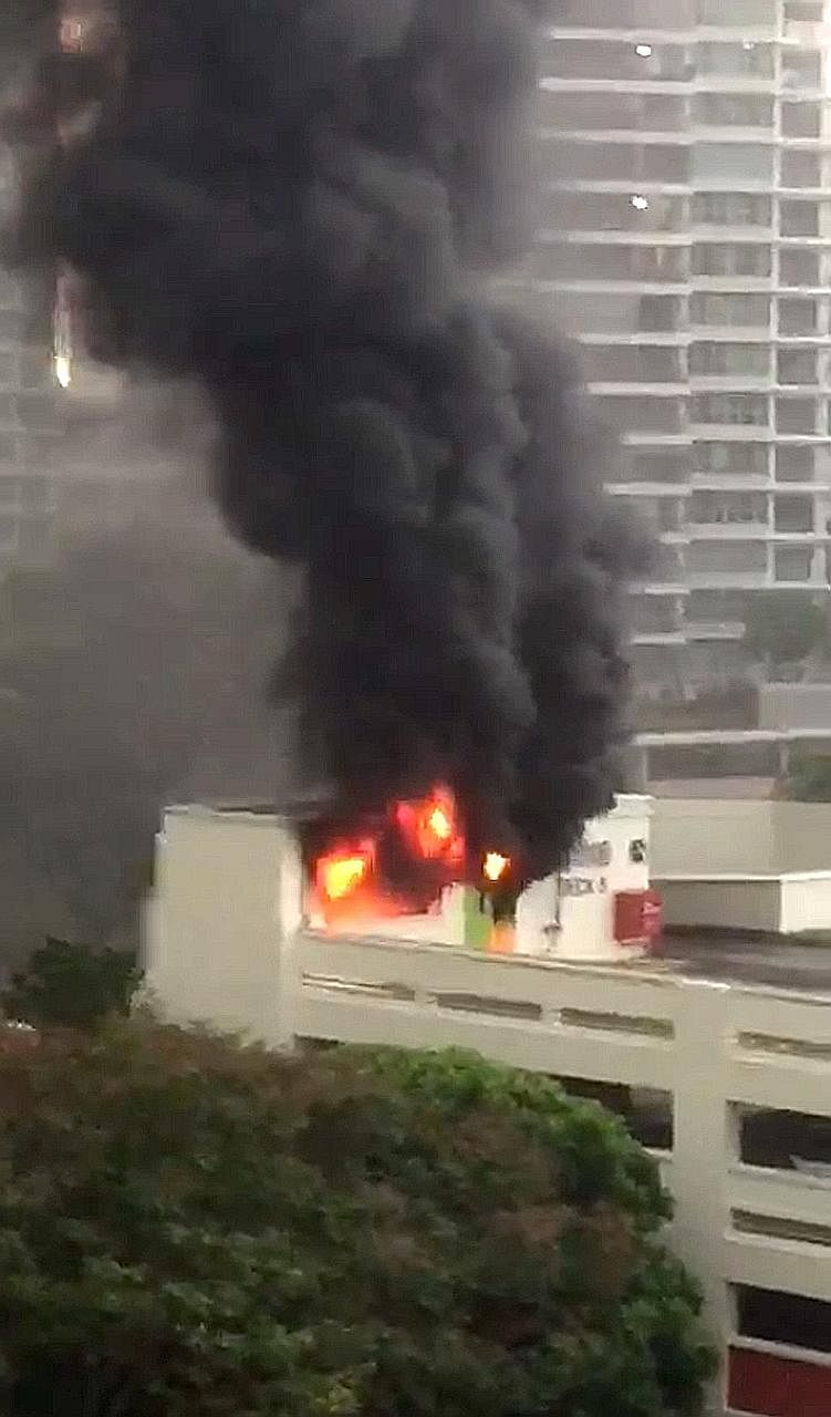 The fire at Block 282, Bishan Street 22 yesterday, as seen from housewife Asther Tung's home in Block 232.