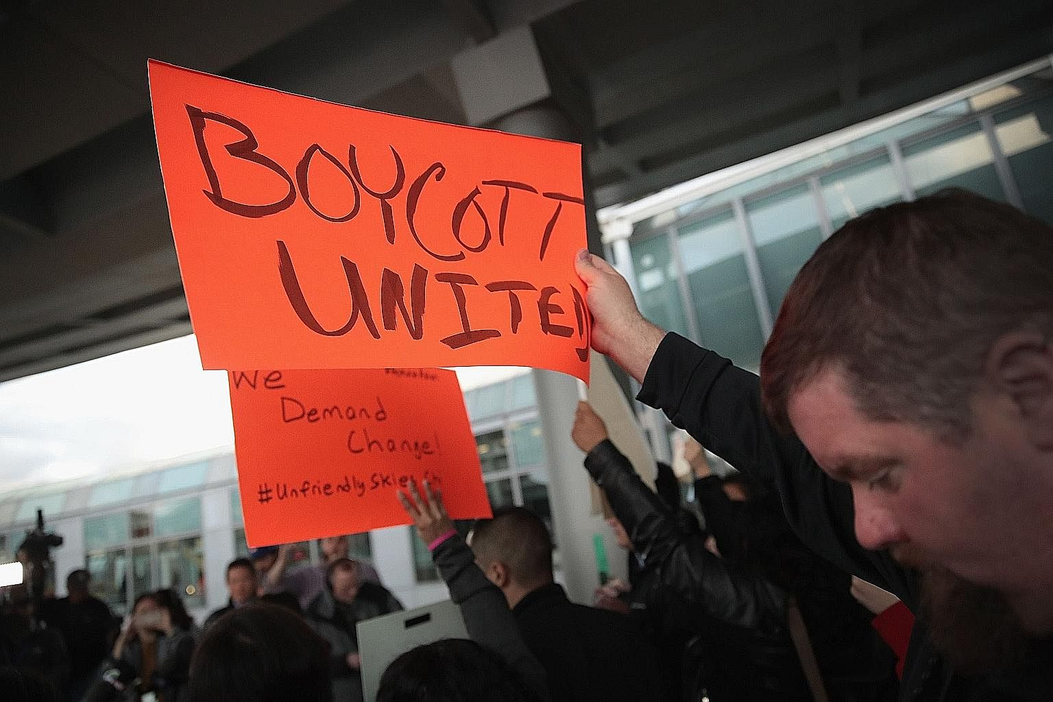 Demonstrators protesting against United Airlines outside Chicago O'Hare International Airport on April 11, after passenger David Dao (above) was dragged off an overbooked flight two days earlier due to the lack of volunteers willing to surrender thei