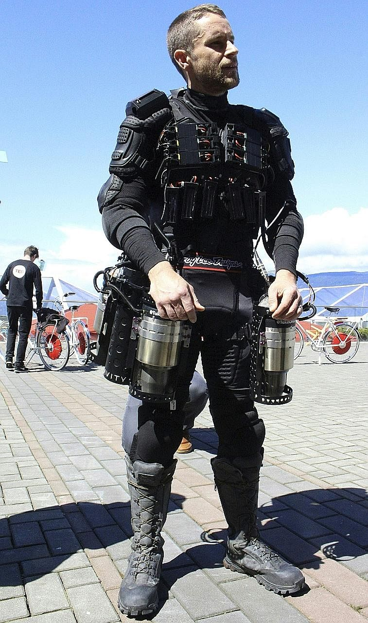 Engineer Richard Browning flew in a circle and hovered a short distance from the ground while wearing the personal flight suit at a TED Conference in Vancouver.