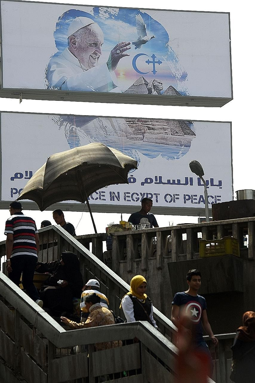 A banner welcoming Pope Francis in Cairo. The Pope hopes his visit would encourage reconciliation with the Islamic world.