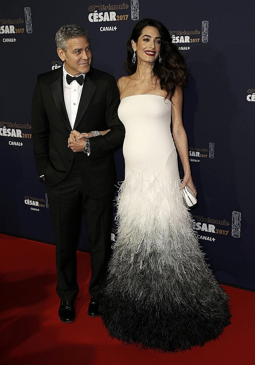 Amal Clooney (below, with husband George) in a strapless white Atelier Versace gown with a feathered train at the Cesar Awards in February this year. In February, Beyonce sported a sheer gold gown (left) at the Grammys and wore a Gucci silk kimono to