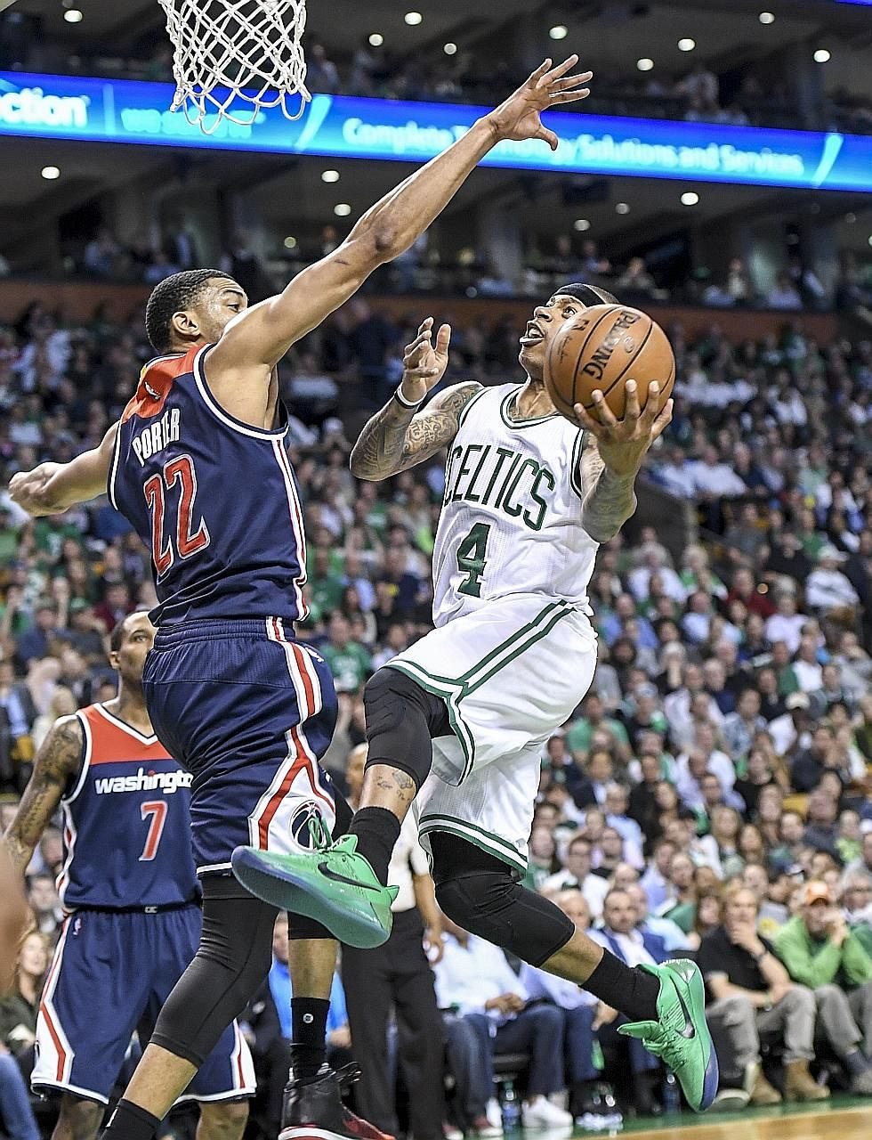 Celtics star Isaiah Thomas driving to the hoop against Wizards forward Otto Porter Jr during Game Two in Boston. Despite going through a six-hour dental procedure the day before, Thomas connected on 18 of 33 shots.