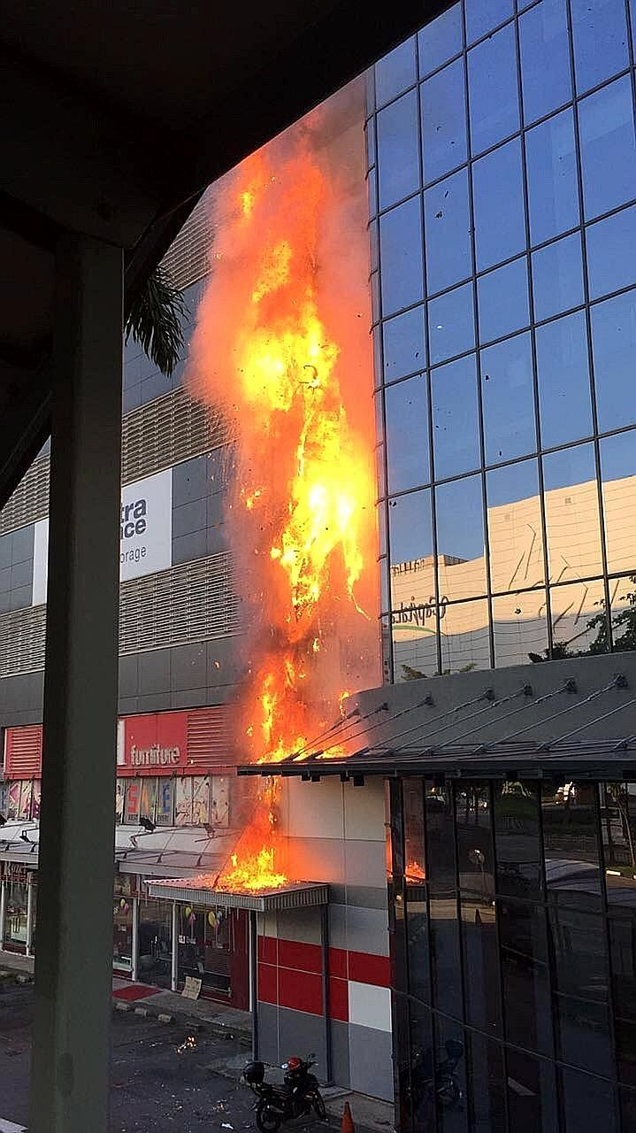 About 50 people were evacuated from the burning building at 30 Toh Guan Road in Jurong yesterday. A 54-year-old woman died after suffering burn injuries.