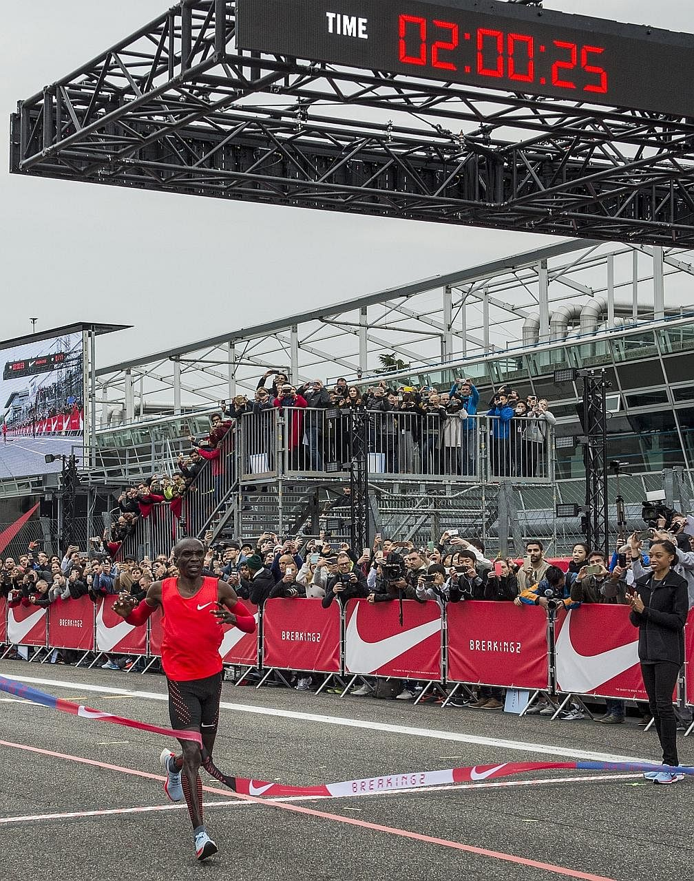Marathon runner Eliud Kipchoge crossing the finish line at the Monza Formula One track in two hours and 25 seconds.