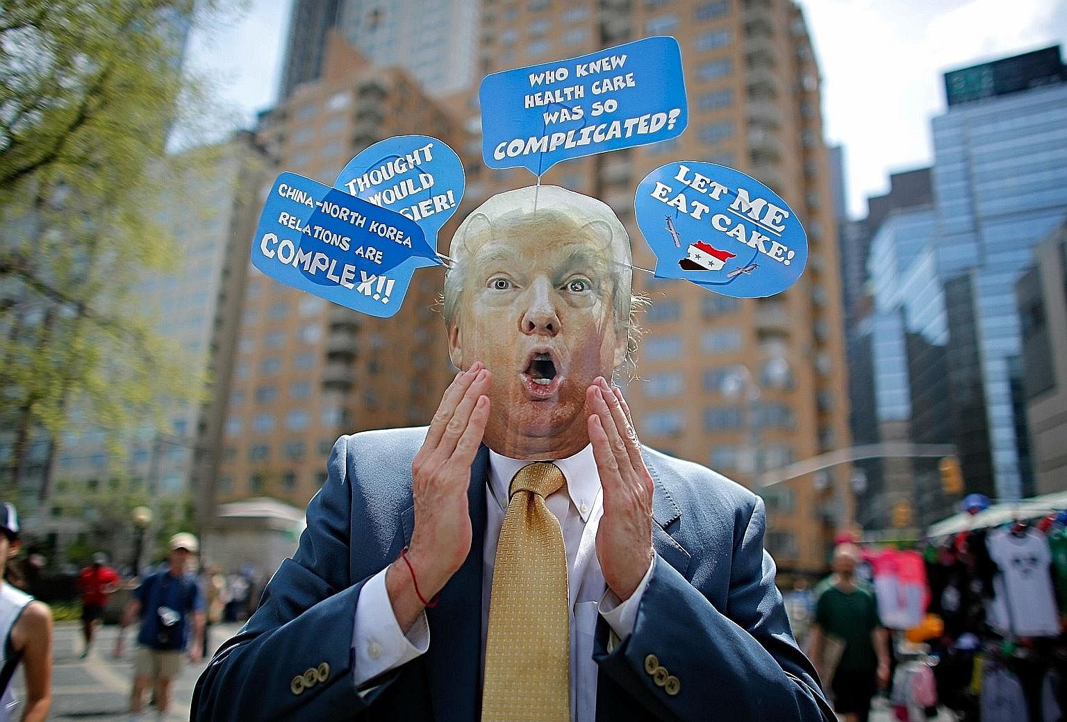 """A man in New York wearing a Donald Trump mask taking part in the """"100 Days of Failure"""" protest on April 29. The surprises from the Trump administration's first 100 days have been both positive and negative."""