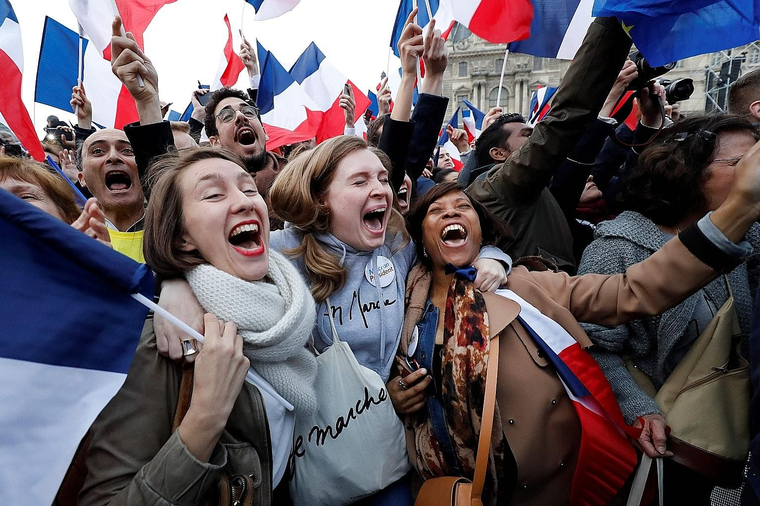 Ecstatic supporters cheering the victory of pro-European Emmanuel Macron in the French presidential election at the Louvre Museum on Sunday. At least Europe is not going down the protectionist path that President Donald Trump is forcing the United St