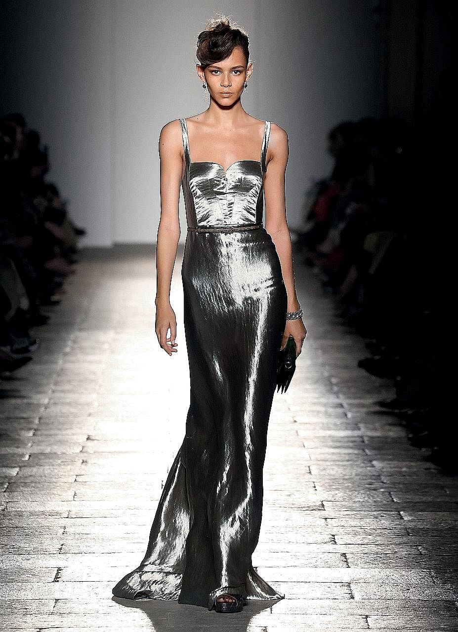Bottega Veneta creative director Tomas Maier (top) rolled out glamorous metallic gowns (left) for his Fall-Winter 2017 collection and his Cabat bag's weaving technique (above) is now used throughout the brand.