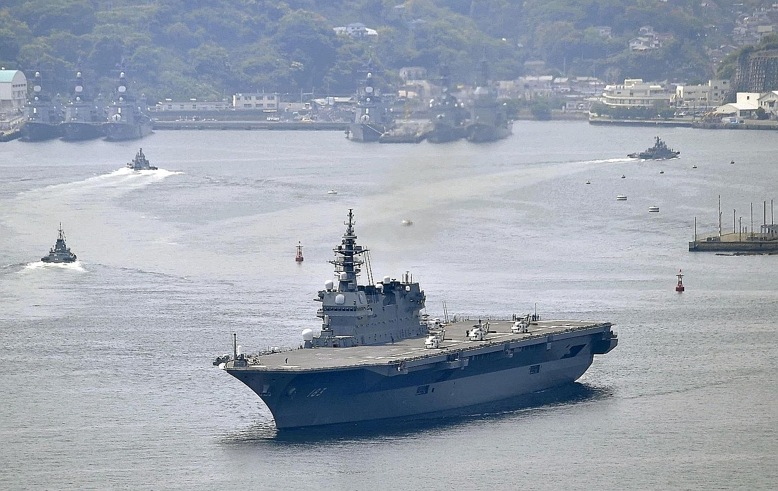 The Izumo leaving Yokosuka base in Kanagawa Prefecture, south-west of Tokyo, on May 1. The warship is on a 100-day voyage, its longest and farthest from Japan, and its first port of call is Singapore.