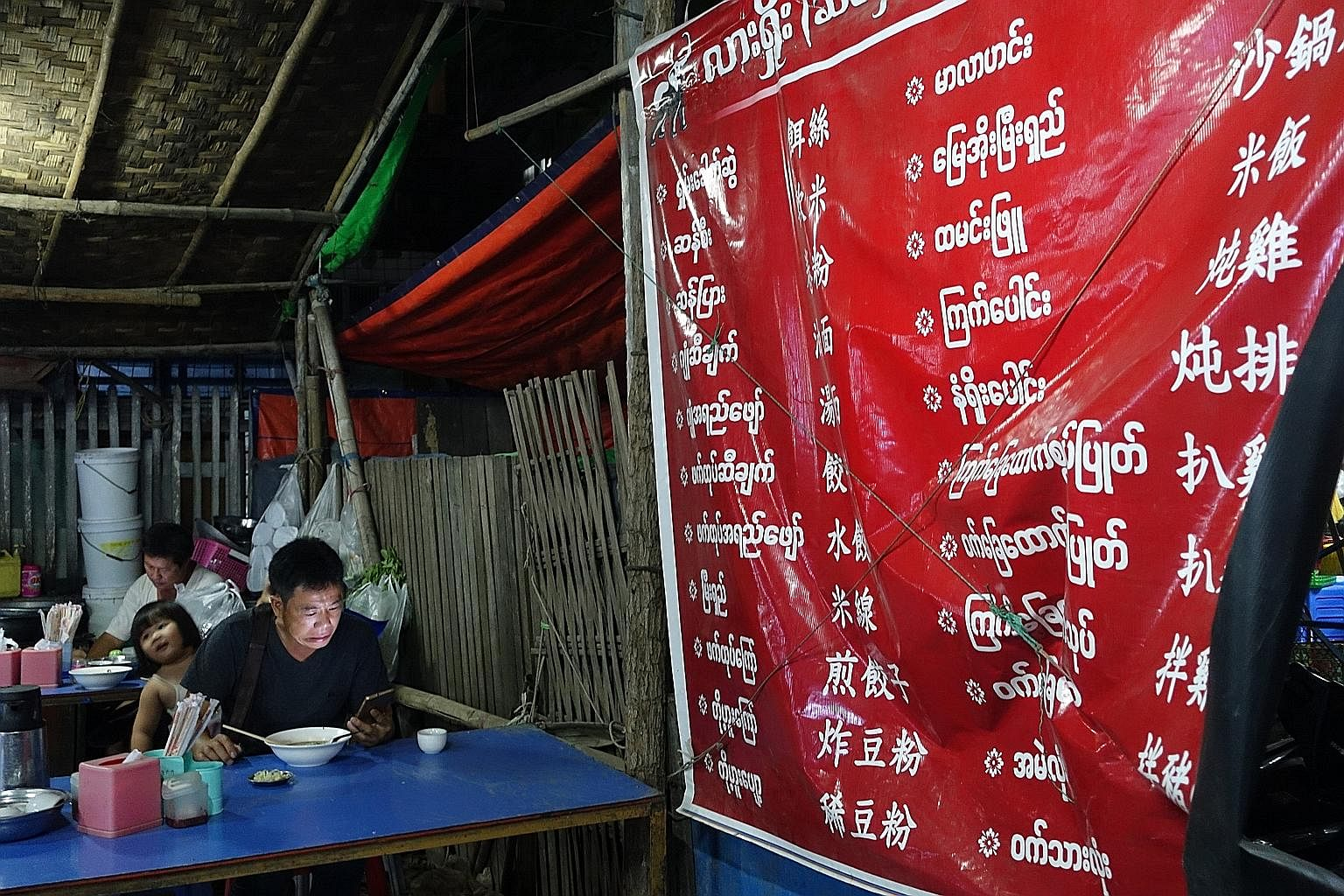 Advertisements for Chinese brands light up downtown Mandalay. The former royal capital, once lined with traditional wooden homes, now bustles with hotpot restaurants and Chinese boutiques selling Duoyi women's fashion, Erke sportswear and Oppo smartp