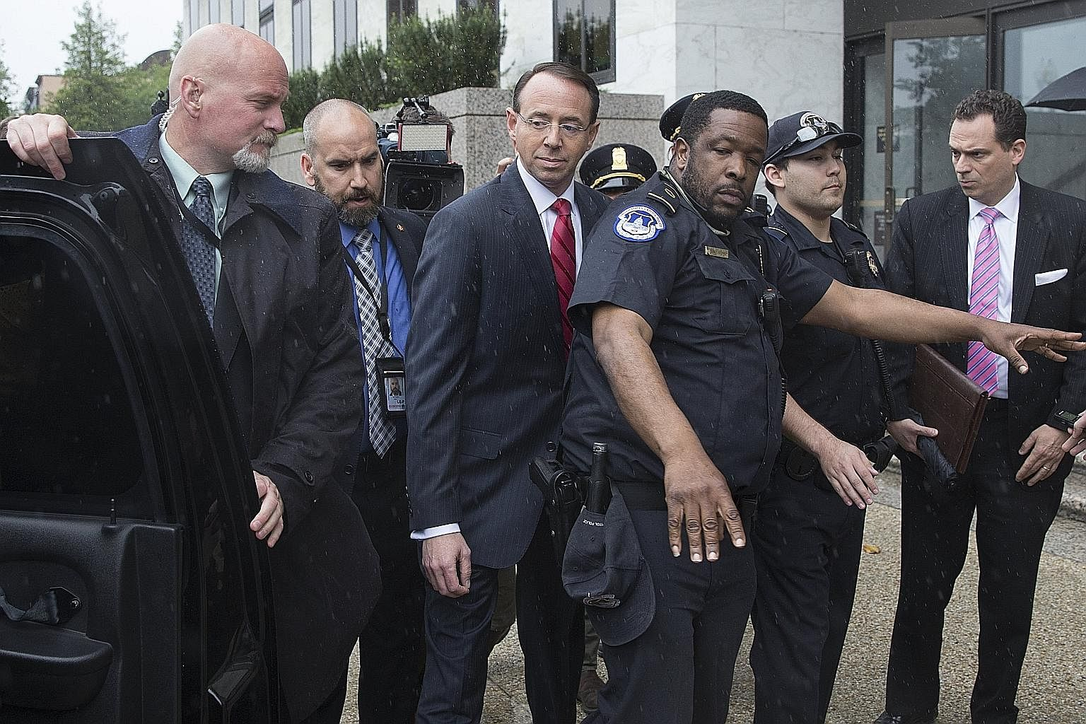 Deputy Attorney-General Rod Rosenstein (centre) on Capitol Hill last week. On Wednesday evening, he announced that he was appointing Mr Robert Mueller, a former FBI director, as special counsel.