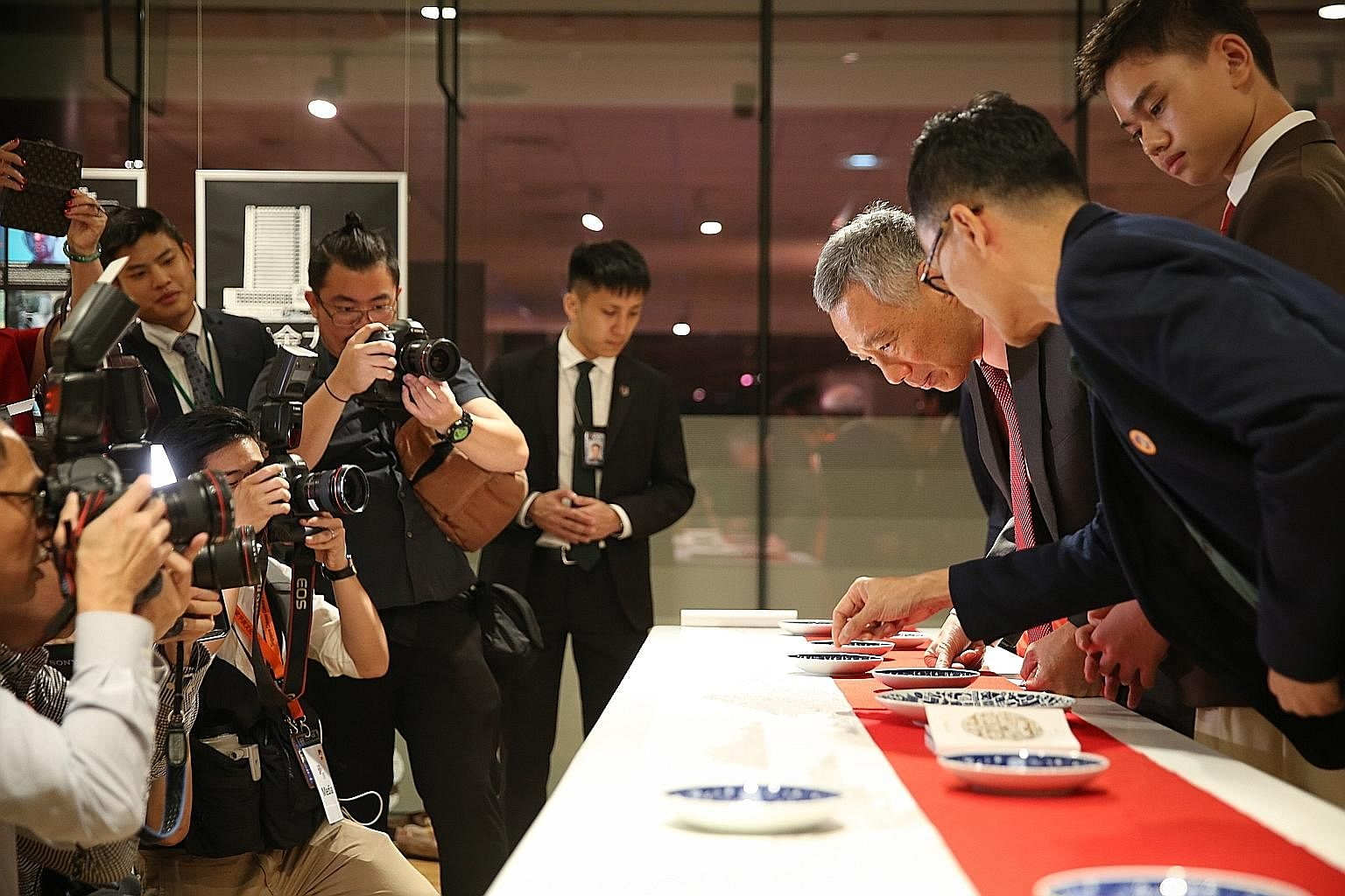 Prime Minister Lee Hsien Loong looking at artist Edwin Low's painting Shan Shui during the opening of the Singapore Chinese Cultural Centre. The centre is a platform that showcases local Chinese arts and culture.