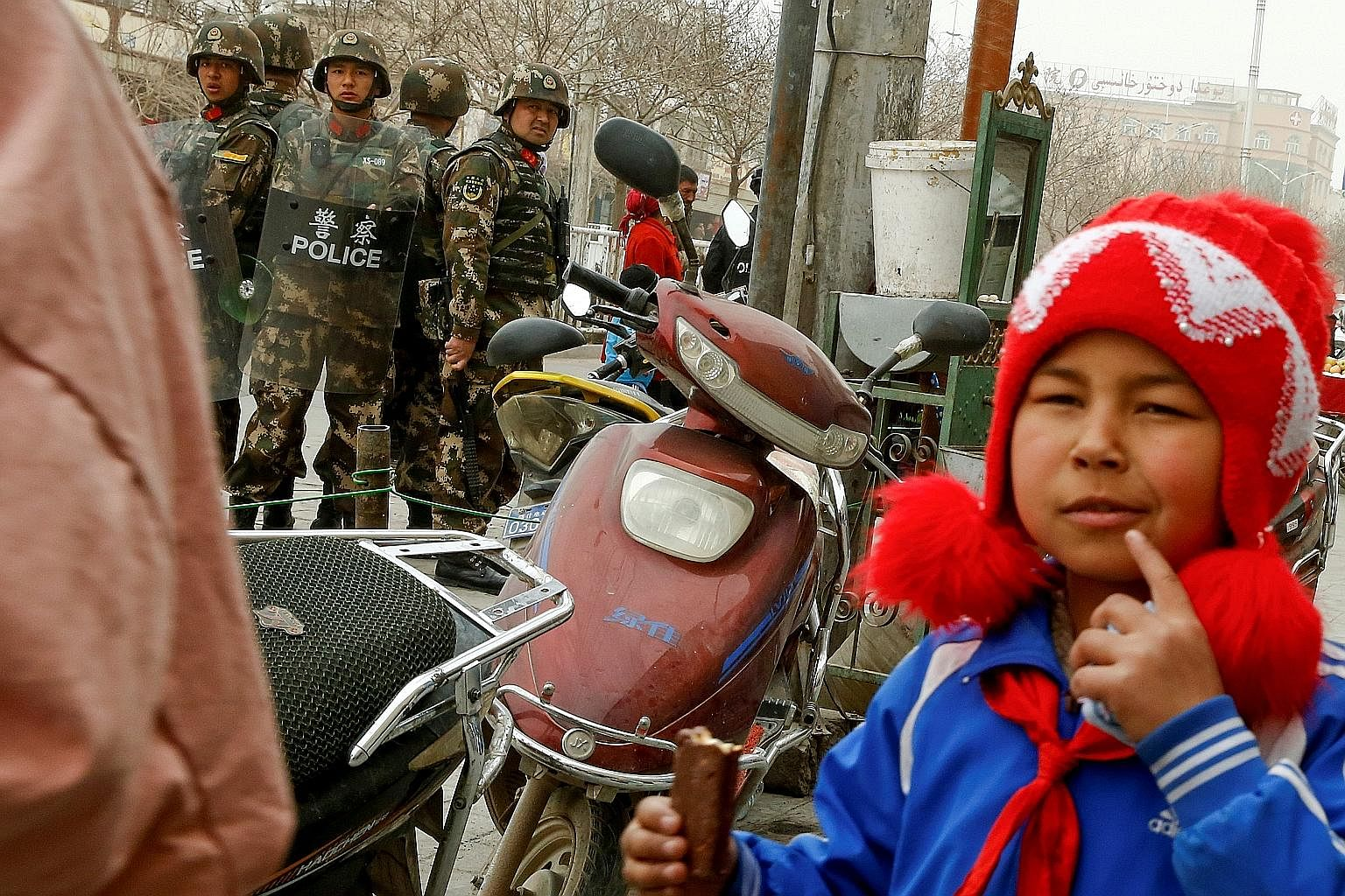 Security personnel in Kashgar city, in the Xinjiang Uighur Autonomous Region of China. The writer says it is true that Chinese Muslims are subject to greater surveillance, but they also receive some preferential exemptions. For example, the on