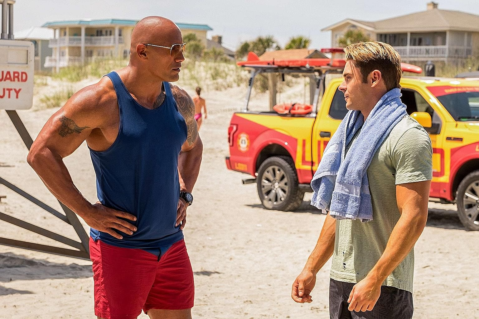 Dwayne Johnson (above left) and Zac Efron in the Baywatch reboot, and Brad Pitt as a general in War Machine.