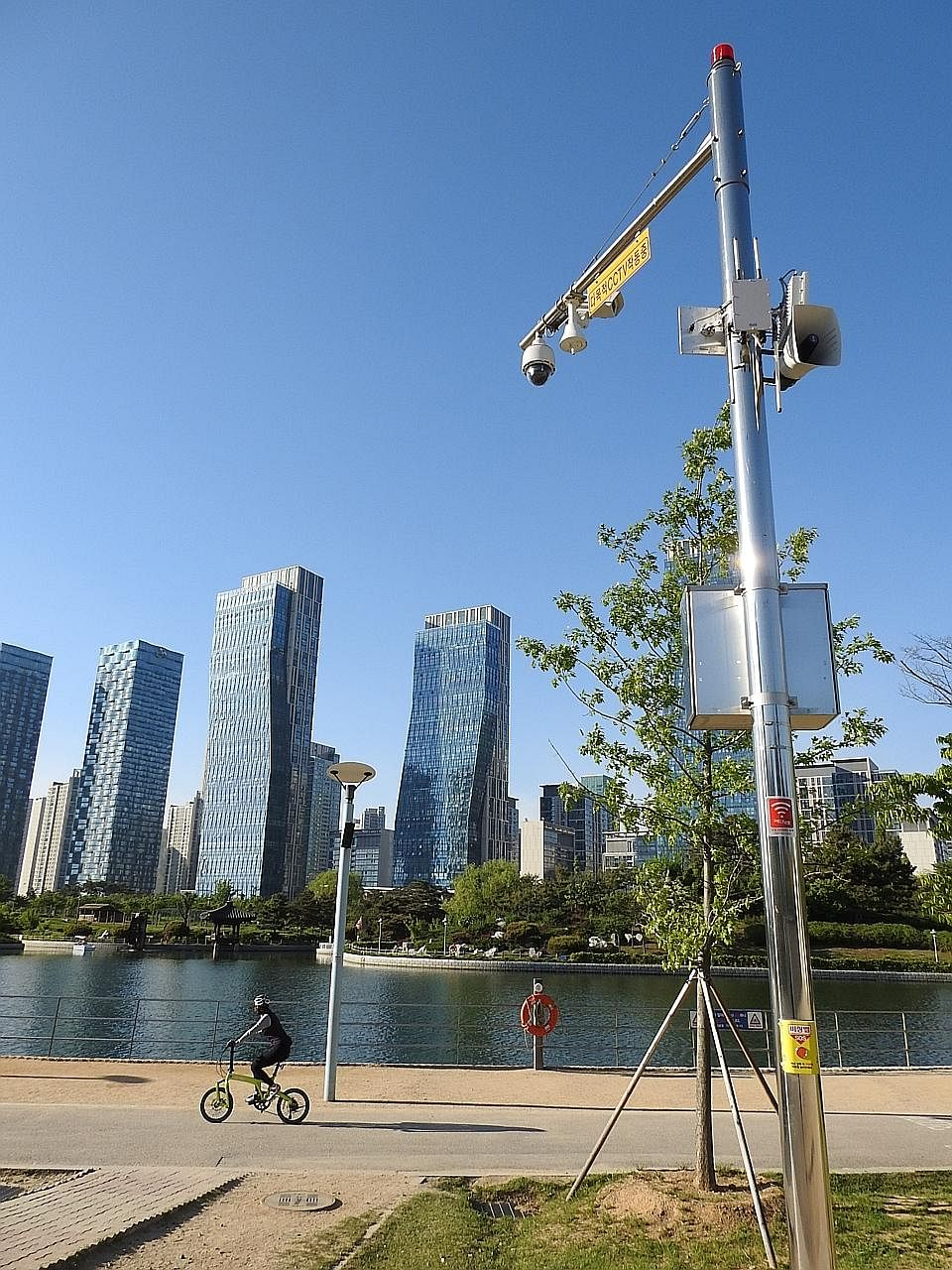Poles in the park are equipped with closed-circuit television cameras and siren bells to offer eme