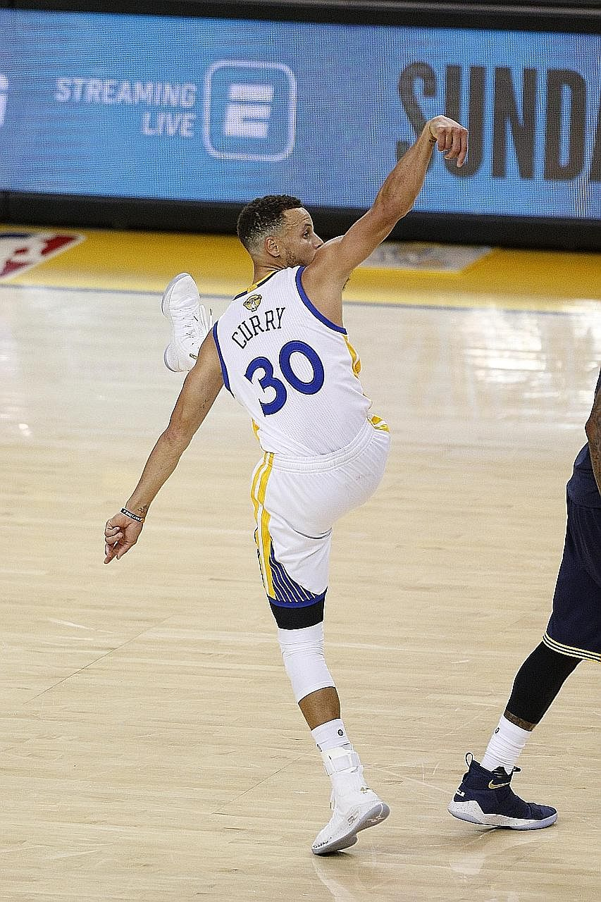Warriors' Stephen Curry celebrating after draining a three-point jumper in Golden State's 113-91 win over Cleveland in Game One of the NBA Finals. With the guard fully fit, the Cavs have their work cut out for them in the rest of the series.