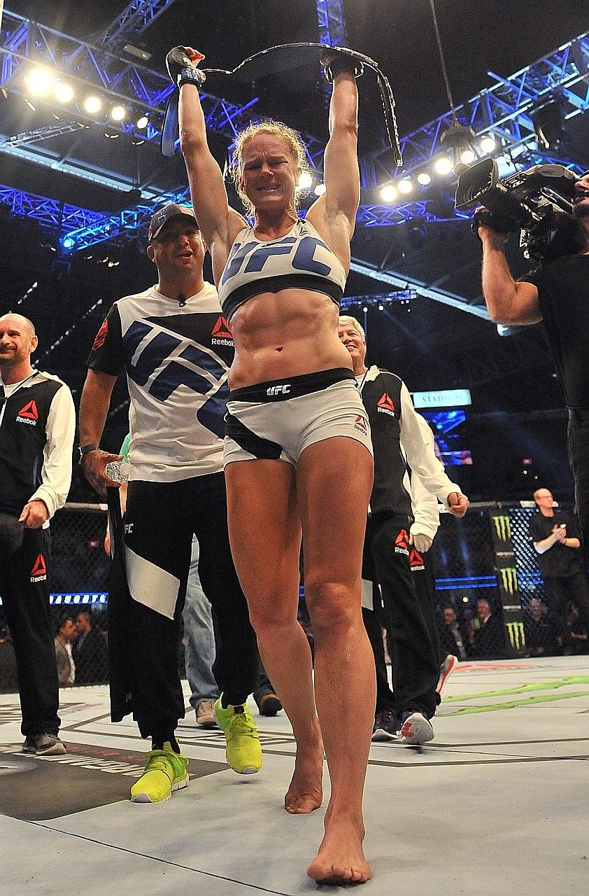 Holly Holm celebrating after ending American compatriot Ronda Rousey's unbeaten streak and three-year reign as UFC bantamweight champion in Melbourne in 2015. But she has since lost her last three bouts.