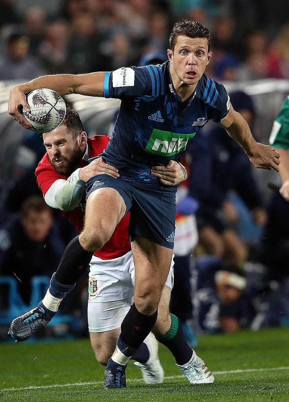 Blues' Matt Duffie is tackled close to the side line by Lions' Elliot Daly. The visitors need to get over their surprise 16-22 loss quickly, with seven-time Super Rugby champions Crusaders up next on Saturday.