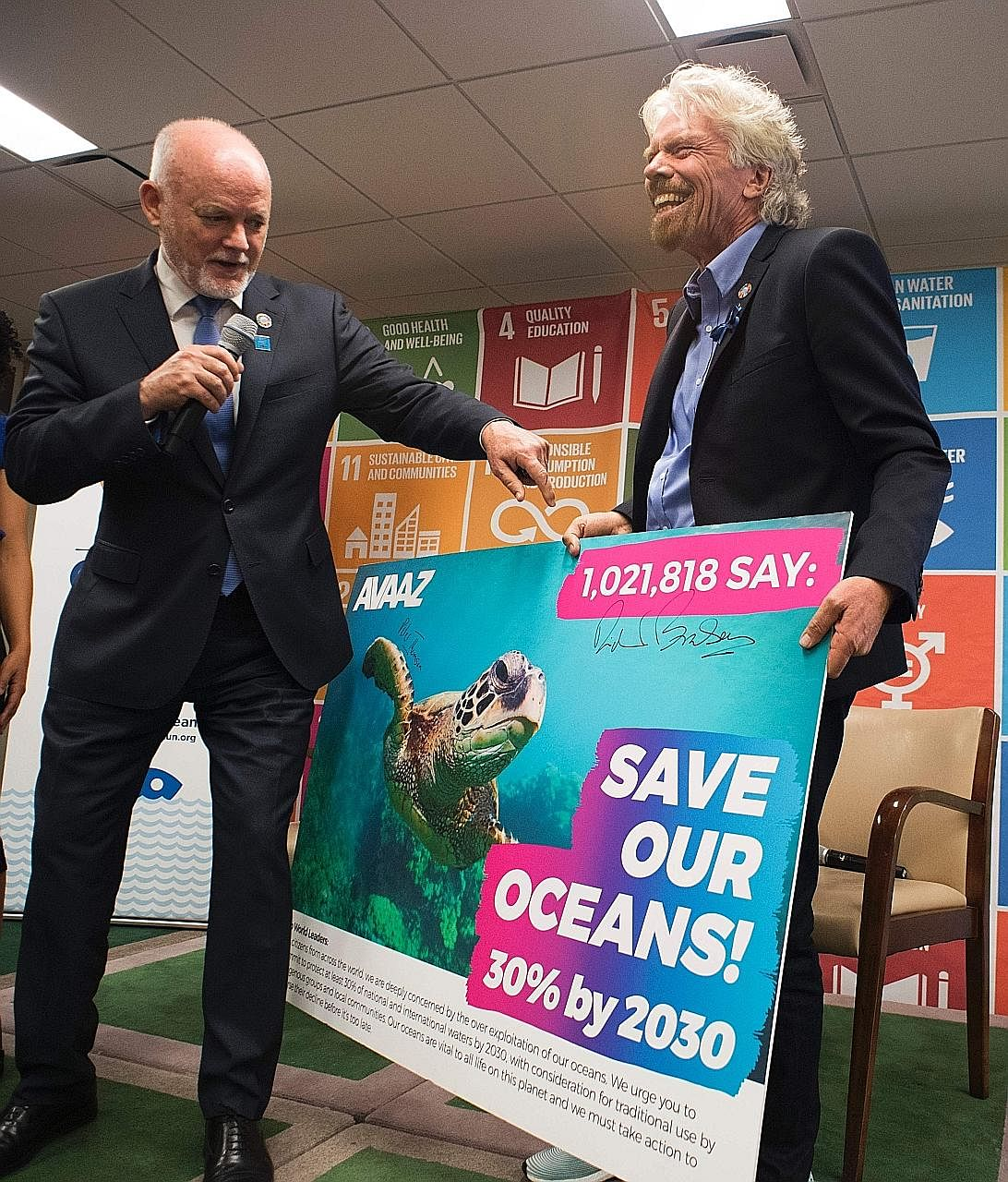 UN General Assembly president Peter Thomson (far left) and Mr Richard Branson with the petition carrying over one million signatures. The petition urges governments to protect at least 30 per cent of the world's oceans by 2030.