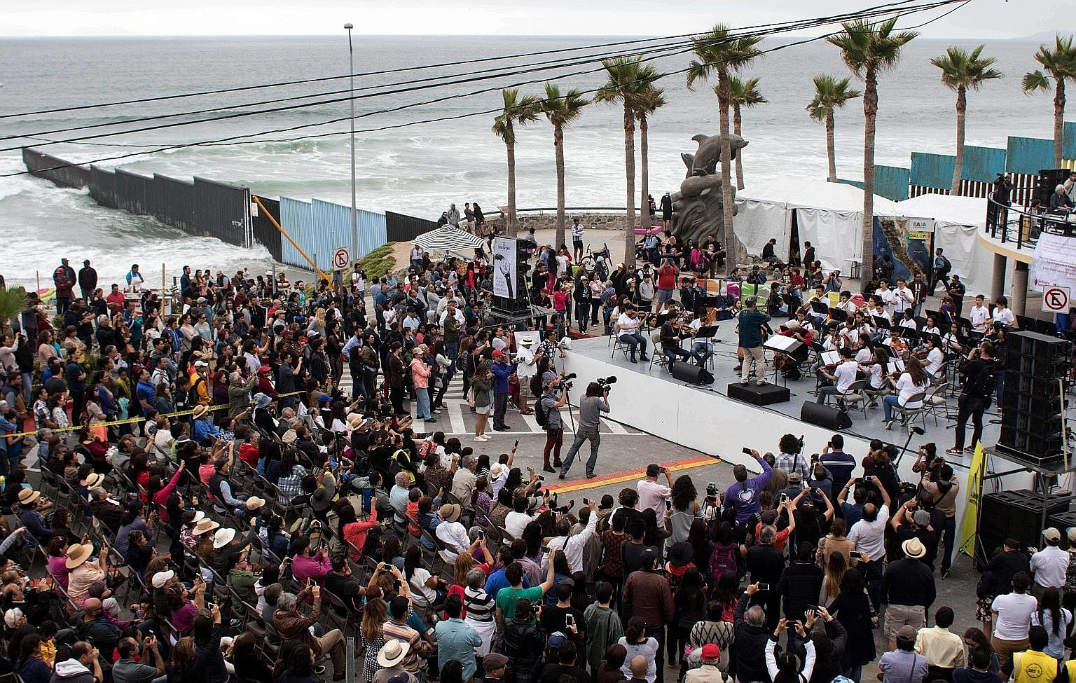 Musicians from the US and Mexico, and from around the world, performed at the Tear Down This Wall concert in Playas de Tijuana, Mexico, on June 3, in protest over Mr Trump's wall. A US Border Patrol agent with two men who were detained for illegally