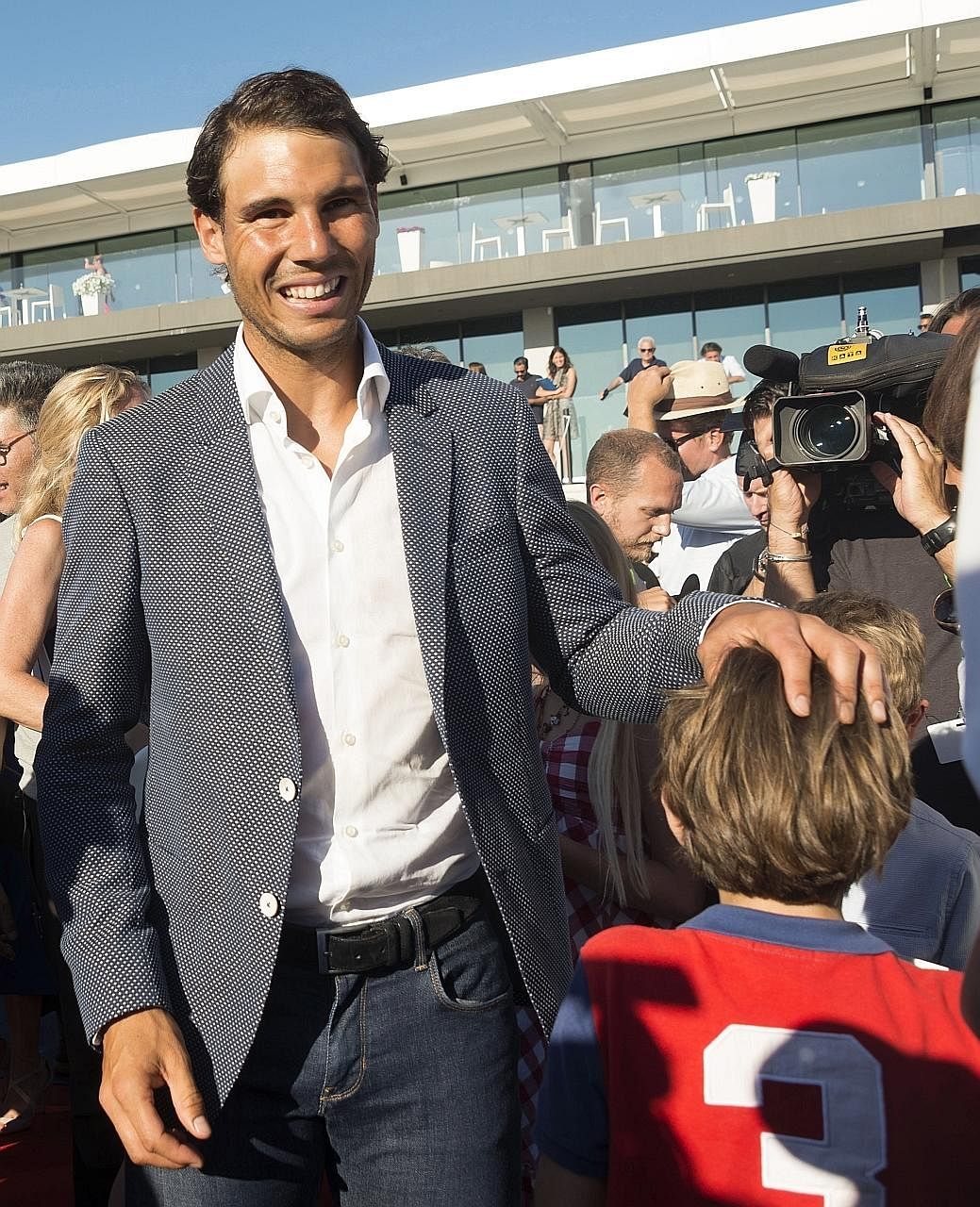 Rafael Nadal attending a graduation ceremony of pupils of the American International School of Mallorca in his tennis academy on Tuesday. The Spaniard had clinched his 10th French Open title on Sunday.
