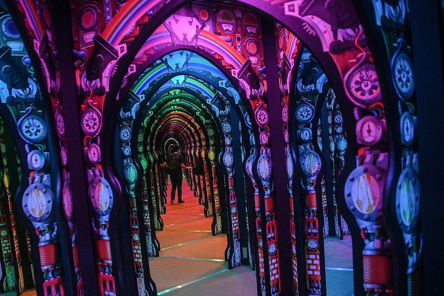 Professor Crackitt's Light Fantastic maze exhibition (above) spreads over 270 sq m of space filled with mirrors and kaleidoscopic displays (left).