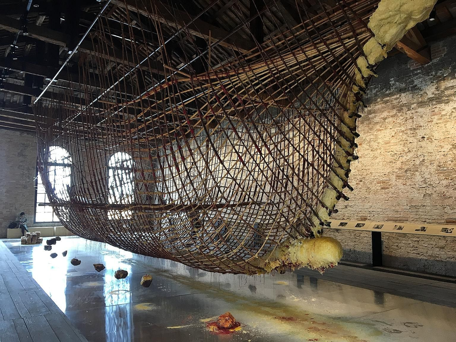 Artist Zai Kuning's suspended ship - the hull of a 12m-long seagoing craft made from rattan and bound together with beeswax and red cord - evokes Singapore's trading roots and the shared Melayu-Riau heritage of its people, says the writer.