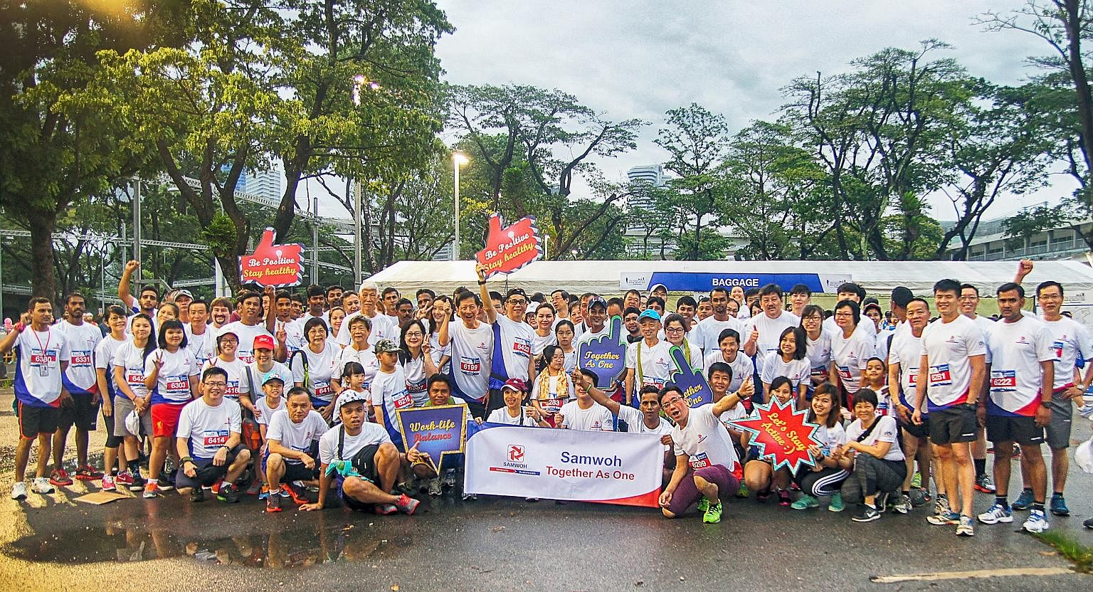 Samwoh employees at last year's ST Run. The firm is participating in the event for the second year running.