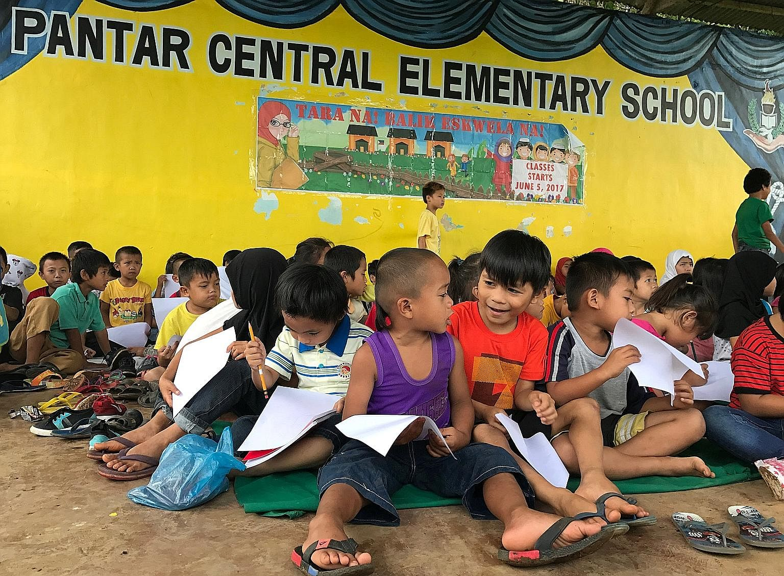 Children putting into drawing what they experienced before fleeing Marawi city at an elementary school in Lanao del Norte in the Philippines this month. Educating the next generation of Muslim youth will go a long way towards slowing the tide of ISIS