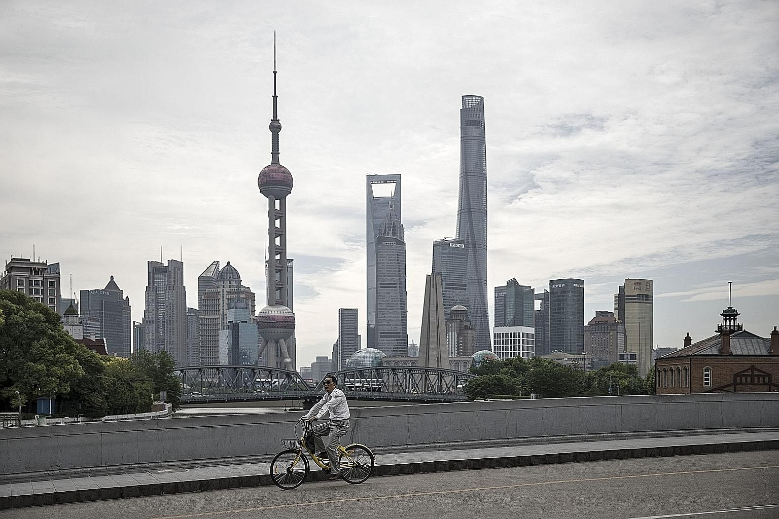 Shanghai, which has some of the world's tallest towers, is facing the growing problem of filling them as China's real estate market undergoes changes.