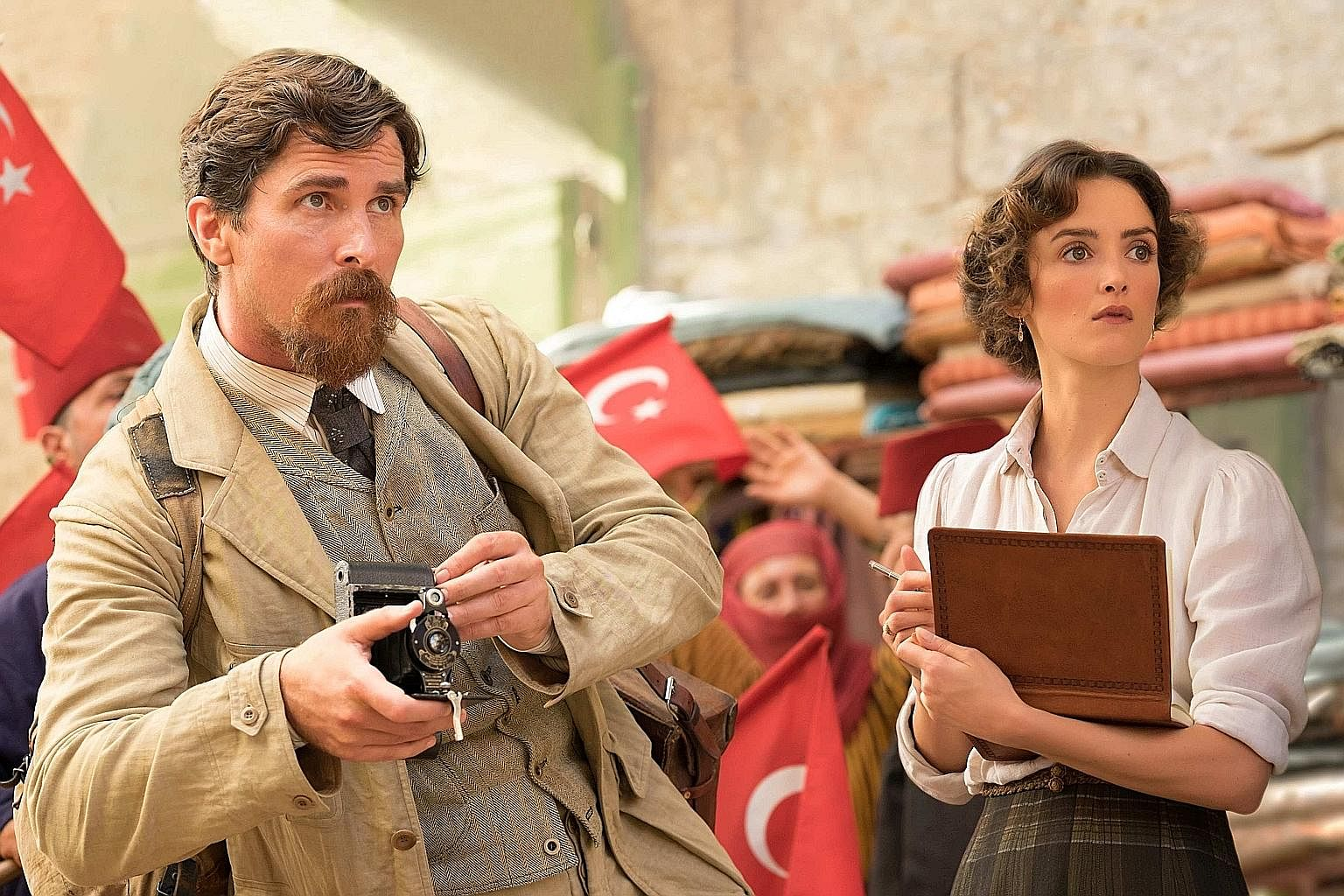 Christian Bale and Charlotte Le Bon (both above) in The Promise.