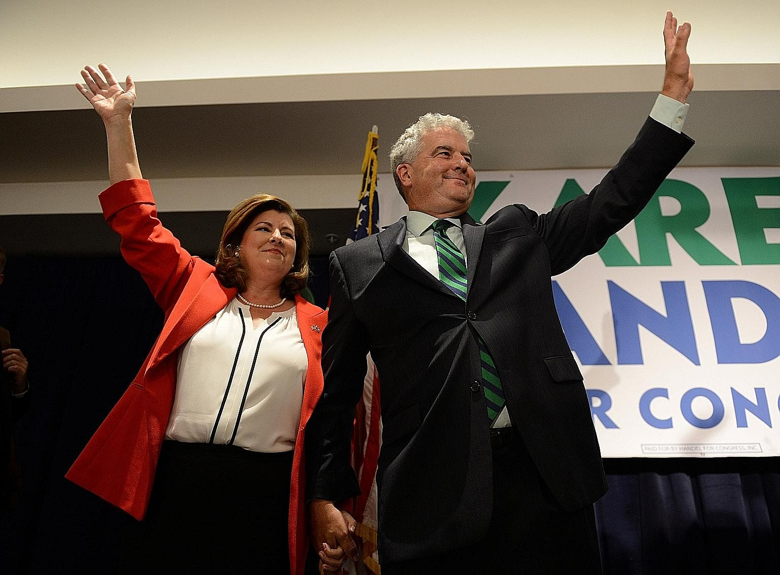 Ms Karen Handel with her husband Steve after her election victory on Tuesday. The Republican won a key contest in Georgia.