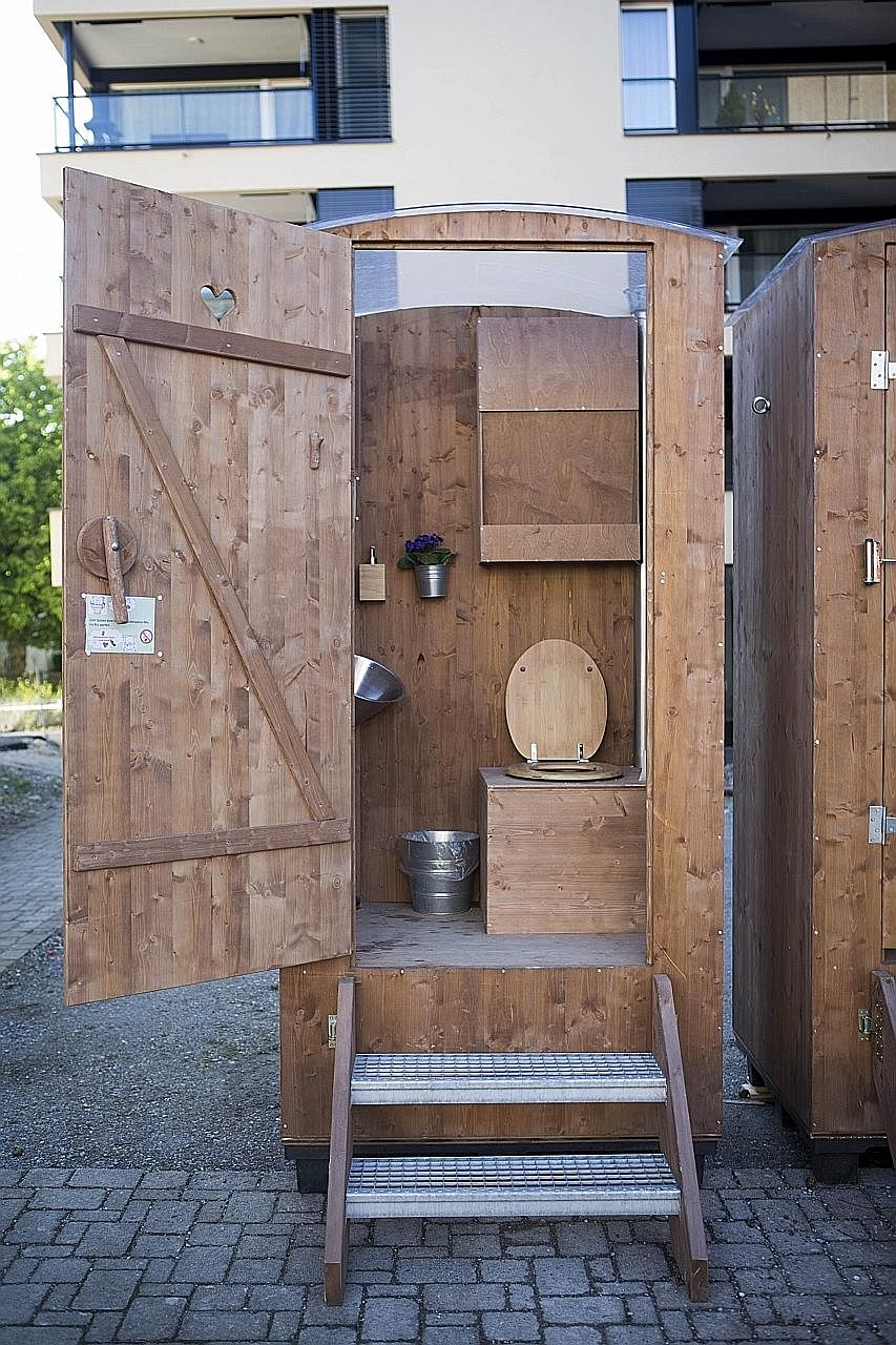 Greenport toilets in Kreuzlingen, Switzerland. Human waste is collected, treated and, after a lengthy process, becomes terra preta or black soil.