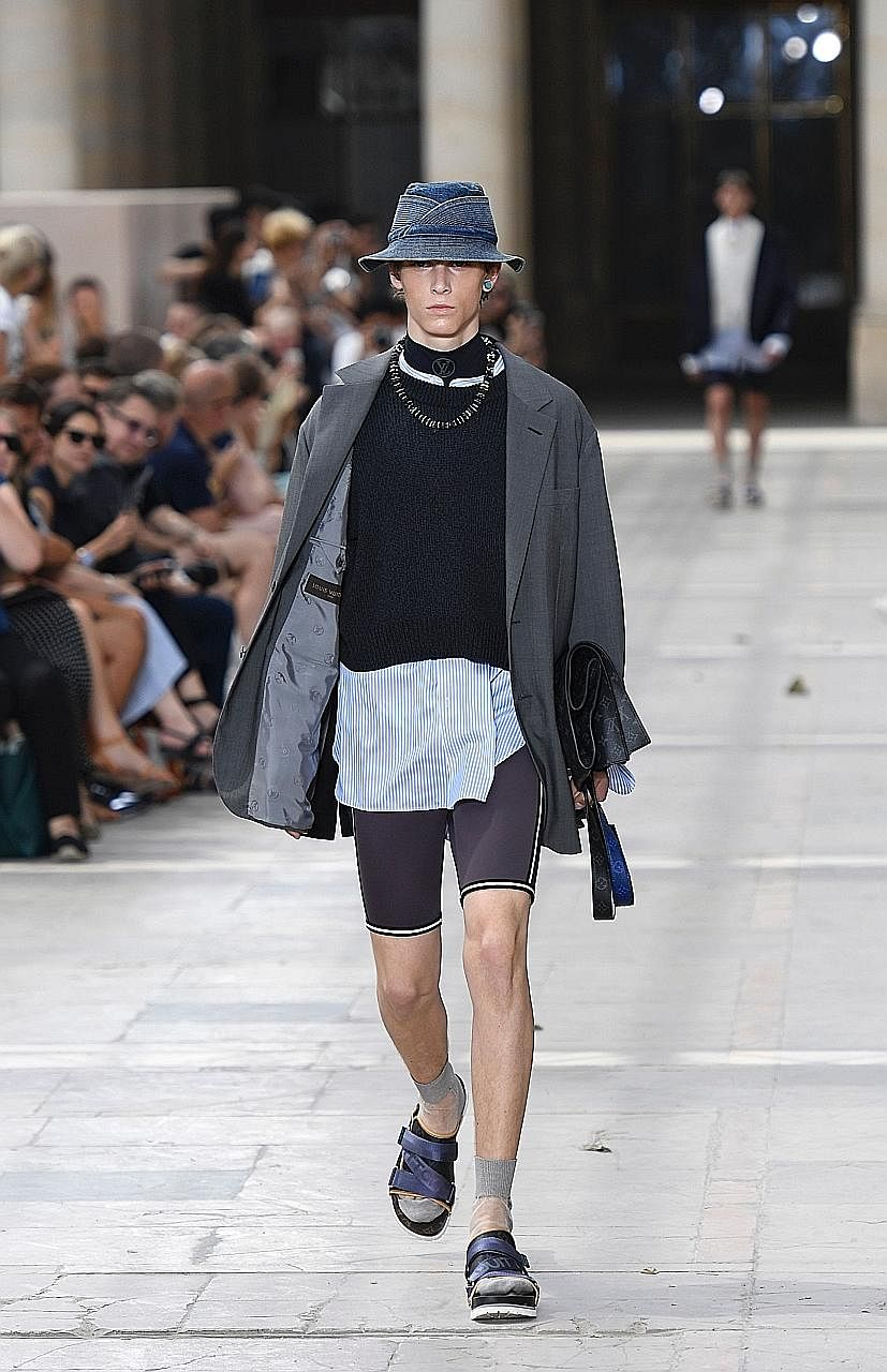7e2a7d6d88f Models in sandals and socks were featured in the Louis Vuitton  Spring Summer 2018 collection