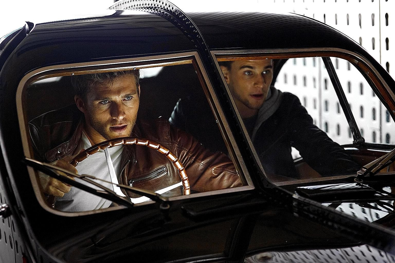 Overdrive stars Scott Eastwood (left) and Freddie Thorp as half-brothers who are genius car thieves.