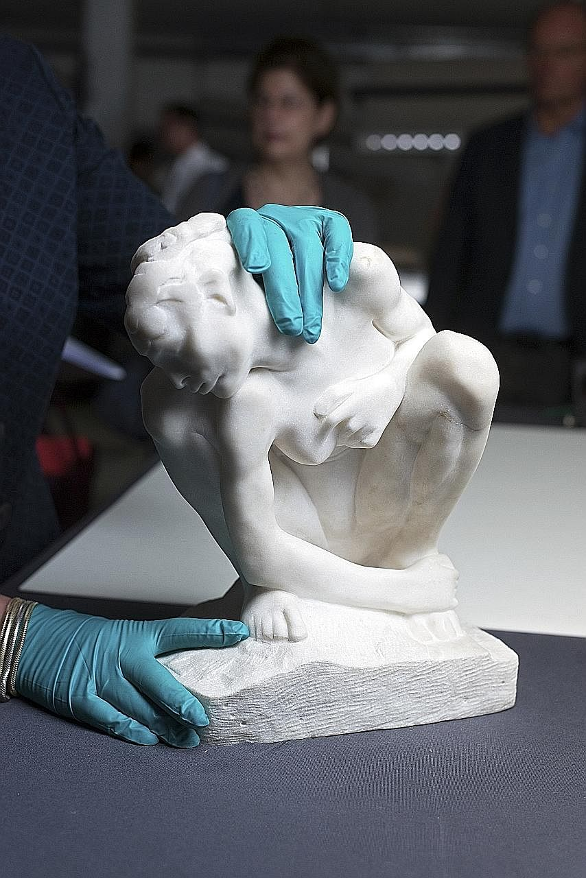 A marble sculpture of a crouching woman by Rodin (left) and a nude sketch by Aristide Maillol (below) are among the artworks found in the homes of a German man, Mr Cornelius Gurlitt, and which will be displayed at the Bundeskunsthalle in Bonn from No