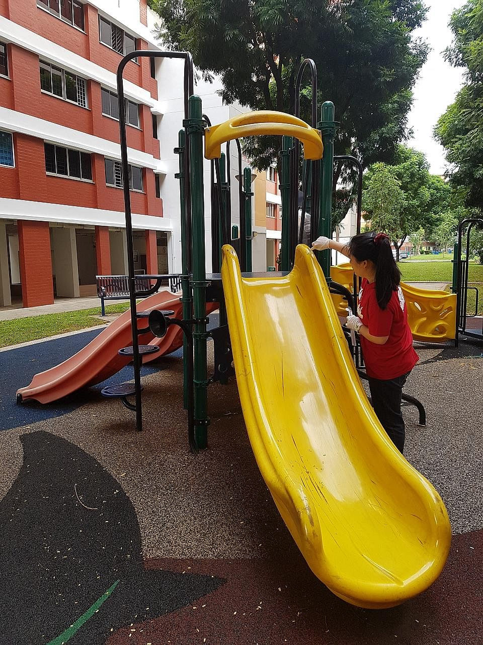 A volunteer from A*Star swabbing the surfaces of a playground in Singapore. The sample is among the 1,000 that will be sent to New York to be analysed for genetic information. The study will give researchers a glimpse of the bacteria, viruses and gen