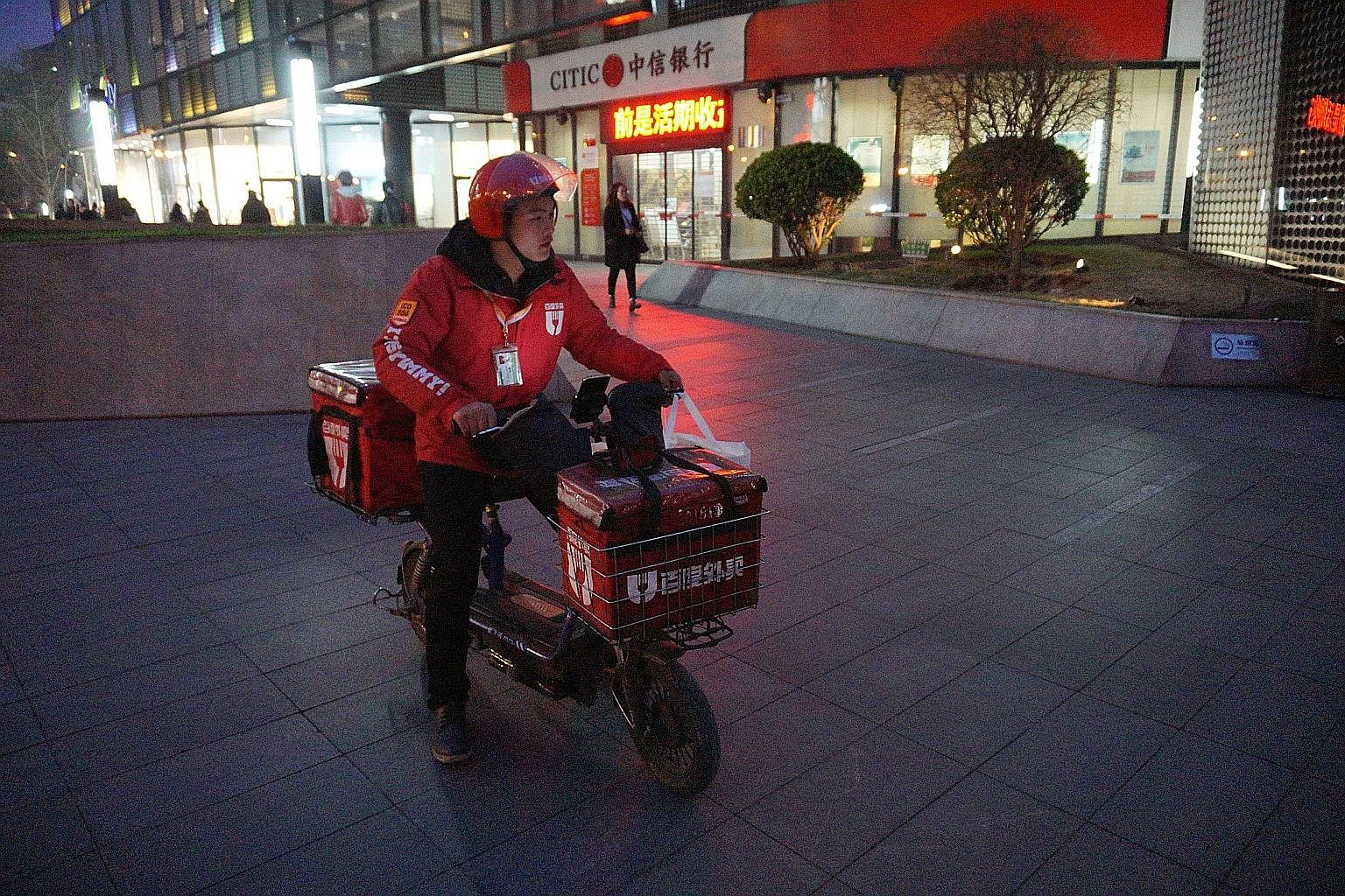 A deliveryman for Chinese food delivery service Baidu Waimai, which belongs to search giant Baidu. Asian technology firms could likely spread into multiple segments and benefit from network effects, such as Chinese Internet firms diversifying into ar