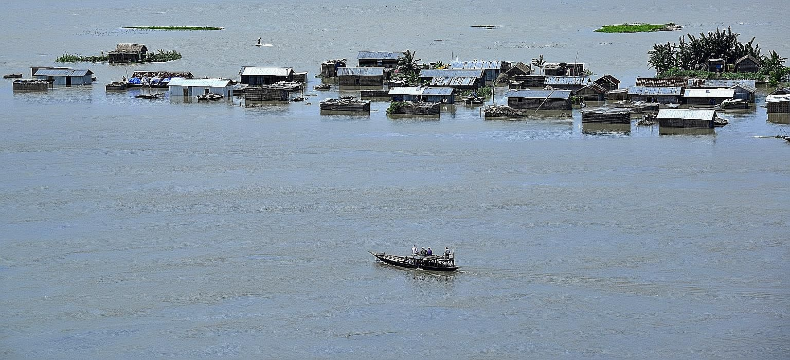 Submerged homes in Assam on Wednesday. Five rivers have risen to dangerous levels.