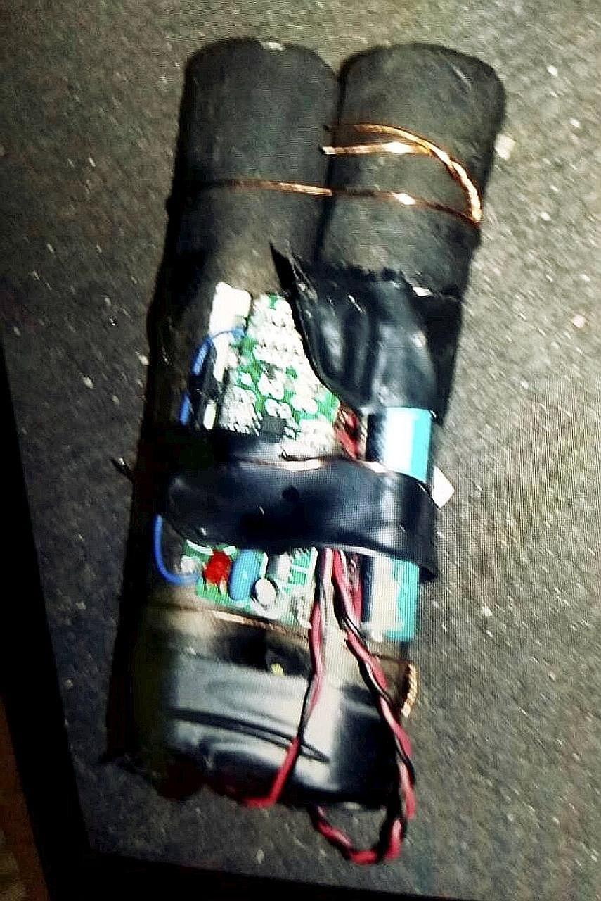 The improvised explosive device comprised two cylinders wrapped in black tape and wires as well as an electronic circuit board and a switch.