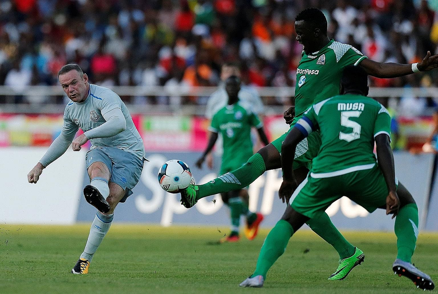 Wayne Rooney scoring Everton's first goal in their pre-season friendly against Kenya's Gor Mahia on Thursday. The Premier League club won 2-1 with teenager Kieran Dowell netting the winner. Rooney aside, Everton have been spending big this summer, si