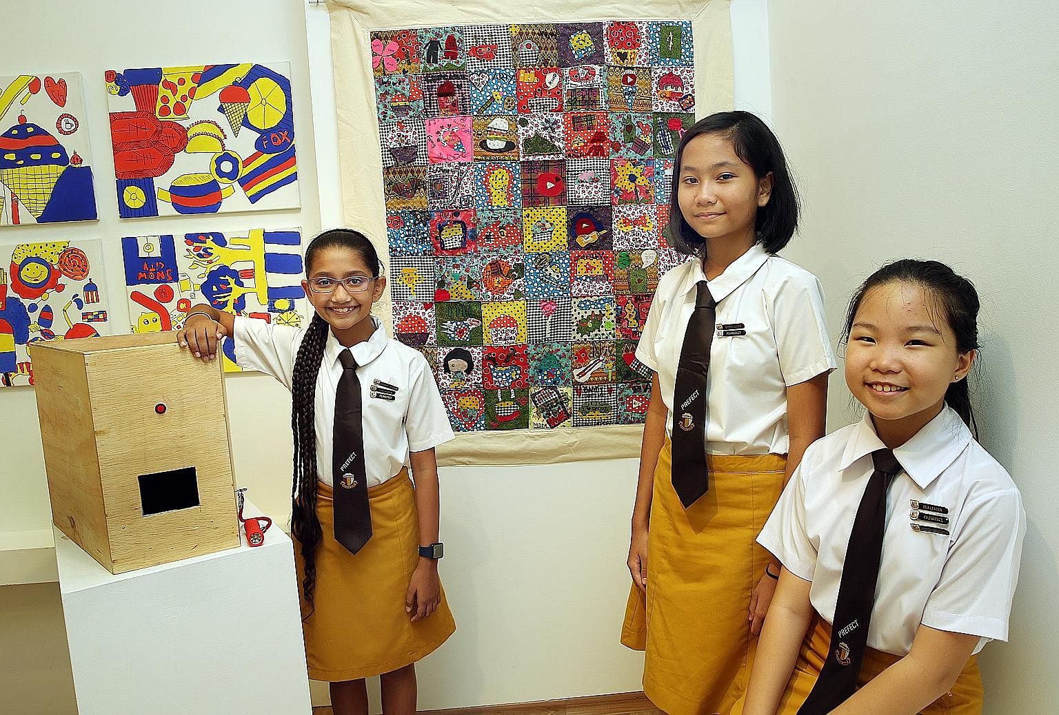 Jasneet Randhawa (far left) and Chantal Setyok with the patchwork quilt created by their class.